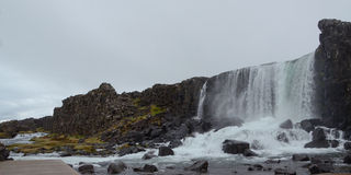 Waterfall at Thingvellir. THINGVELLIR, ICELAND - JUN 17:  Oxararfoss, a waterfall in Thingvellir National Park, Iceland shown on June 17, 2015, is one of its Royalty Free Stock Photos