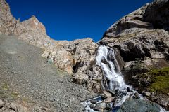 Waterfall in Tien Shan mountains Stock Photography