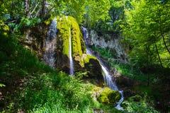 Waterfall in top of mountain stock photos