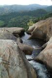 River on mountain. River on summit of rocky mountain at top of waterfall, Sri Lanka Stock Photos
