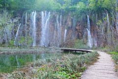 Waterfall and tourist path in Plitvice lakes park Royalty Free Stock Photos
