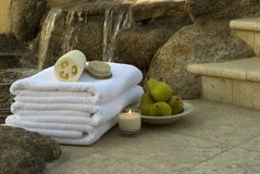 Waterfall towels 3. Spa essentials with towels and pears and candles Stock Photo