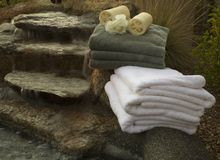 Waterfall and towels 5. Waterfall at spa with towels and candles Royalty Free Stock Images