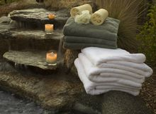 Waterfall and towels 5. Waterfall at spa with towels and candles Royalty Free Stock Image