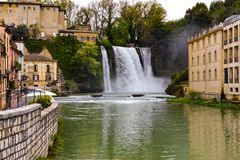 Waterfall in the town Royalty Free Stock Image
