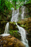 Waterfall. Tranquil scene of beautiful waterfall hidden deep in the forest Stock Photos