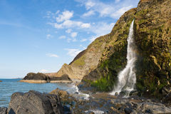 Waterfall at Tresaith Beach Stock Images