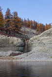 Waterfall on a tributary of the taiga river in Siberia Stock Images