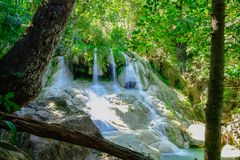 Waterfall in tropical deep forest at Erawan National Park Stock Photos