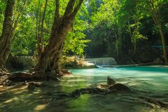 Waterfall in tropical deep forest at Erawan National Park Royalty Free Stock Photo
