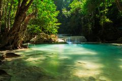 Waterfall in tropical deep forest at Erawan National Park Stock Image