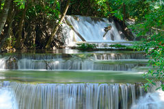 Waterfall in tropical deep forest at Huay Maekhamin Stock Image