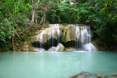 Waterfall in tropical forest. A famous Waterfall in Thailand called Erawan Royalty Free Stock Photo
