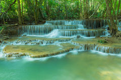 Waterfall in tropical forest at National park Kanchanaburi province Royalty Free Stock Photo