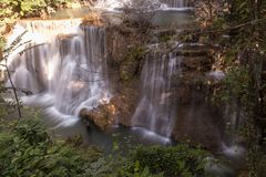 Waterfall in tropical forest at the national park in Thailand royalty free stock images