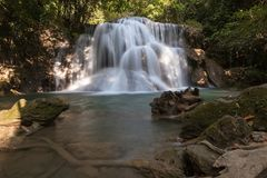 Waterfall in tropical forest at the national park in Thailand Stock Image
