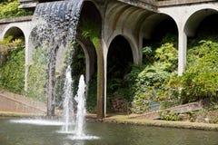 Waterfall in tropical garden Stock Photos