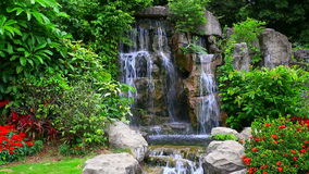 Waterfall in tropical garden stock video footage