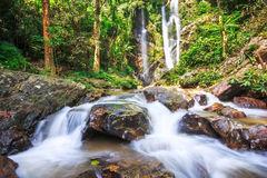 Waterfall in tropical rainforest. Waterfall in the tropical rainforest in thailand Stock Photos