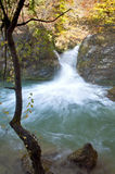 Waterfall and turquoise in Urederra river, Navarre. Waterfall and turquoise water in Urederra river, Navarre Stock Images