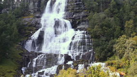 Waterfall Tvindefossen in sunny summer day, Norway stock footage