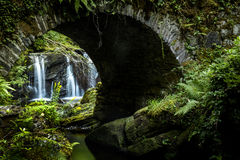 A waterfall under the bridge Royalty Free Stock Photography