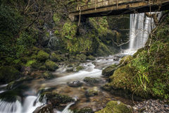 Waterfall under an old brigdge Stock Photography