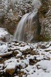 Waterfall under the snow stock photos