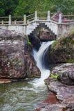 Waterfall under the stone bridge Stock Photo