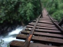 Waterfall under the wooden bridge at forest Royalty Free Stock Photography