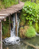 Waterfall under wooden path Royalty Free Stock Photography