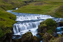 A waterfall up the stream on a river Skóga royalty free stock photos