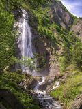 A waterfall, Valais, Switzerland stock images