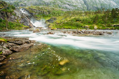 Waterfall in the Valley of waterfalls in Norway Stock Images
