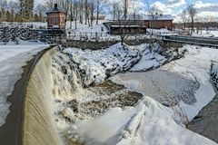 Waterfall in Vanhankaupunginkoski and old power station, Helsink stock photography