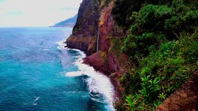 Waterfall veil of the bride from the rock in Madeira island. Seixal. stock footage
