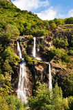 Waterfall view in mountains. Stock Photo