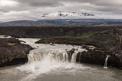 Waterfall in the volcanic mountains of Iceland Royalty Free Stock Photo