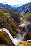 The waterfall Voringfossen and the river flowing through the gor Royalty Free Stock Image