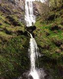 The green waterfall. A waterfall of wales, inbetween the earth at the centre of nature Stock Photo