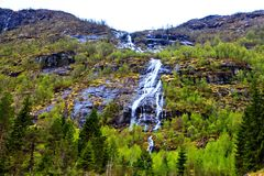 Waterfall washing the face of the mountain, Norway Royalty Free Stock Photo