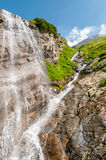 Waterfall. Water falling from a rocky cliff Stock Image