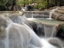 Waterfall with water flowing around. In thailand Royalty Free Stock Photo