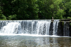 Waterfall. Water flowing over a dam stock photography