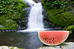 Waterfall and watermelon Stock Photography