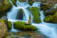 Waterfall waters and zen stones. Background waterfall waters and zen stones.Peace and relaxing Stock Photos