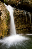 Waterfall. Watterfall falling into a pond - long exposure Royalty Free Stock Photography
