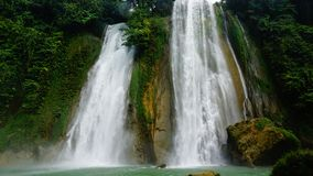 Waterfall at West java Indonesia. A beautiful river, waterfall and forest at sukabumi west java, indonesia stock images