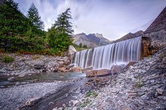 Waterfall in western alps. Italy-France frontier, Chianale, Vallevaraita Royalty Free Stock Photo