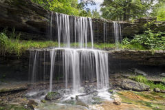 Waterfall in Wheeling`s Oglebay Park. Water splashes over the two-tiered plunge of the waterfall at Oglebay Park in Wheeling, West Virginia Stock Images